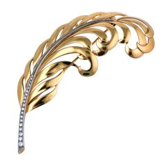 Oversized Retro feather spray by Tiffany  & Co. in 14k gold with a spine of diamonds set in platinum. 1940s USA.