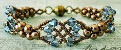 Linda's Crafty Inspirations - smukt armbånd i brun-kobber-bronze og turkise-lysblå bicones
