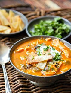 This Chicken Tortilla Soup has the most flavorful broth you will ever try. The trick is pureeing the tomatoes, onions and garlic for maximum flavor!