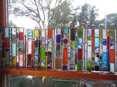 The customer who received these panels ordered 6 for her bathroom window. Jewel tones in orange, blue, green, purple, yellow, red with lots of blown glass. ALL THE PRETTY COLORS. Each panel will be puttied into a bathroom window. These panels are done in lead as opposed to copper