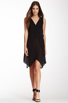 """Handkerchief Hem Silk Dress in nero by Fendi $1290 - $595 at HauteLook. - Split neck with self-tie closure - Seamed waist with handkerchief layer detail - Handkerchief hem - Raw edges throughout - Approx. 33"""" shortest length, 39"""" longest length - Made in Italy Additional Information Fit: this style fits true to size. Model's stats: - Height: 5'10"""" - Bust: 32"""" - Waist: 25"""" - Hips: 35"""" Model is wearing size 42. Sizing is Italian. Dry clean. 100% silk."""