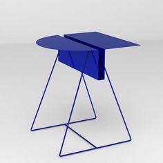 Steel magazine end table designed by Thomas Elliott Burns.