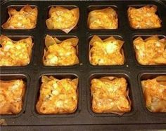 Buffalo Chicken Cups Ingredients 1 (8 ounce) package cream cheese, softened 1/2 cup Ranch dressing 1/2 cup Buffalo wing sauce (Frank's is the brand I like) 1 cup shredded cheddar cheese, divided 1 1/2 cups cooked and shredded chicken 24 wonton wrappers 1/4 cup blue cheese crumbles Directions 1. Preheat oven to 375 degrees. Spray brownie pan very lightly with kitchen spritzer. 2. In a medium bowl, combine softened cream cheese, Ranch dressing, wing sauce and 3/4 cheddar cheese (save ...