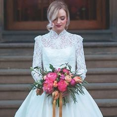A beautiful high-necked Sassi Holford gown and bright, bright, bright pink and purple bouquet