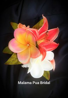 Real touch Hawaiian Plumeria with hand wired Swarovski pearls and Tahitian COral real touch lily create this one of a kind hair accessory.