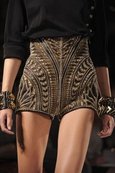 dazzle. – ​High waisted beaded shorts, gold shorts, black essential silk shirt, modern metal jewelry, studded bangles