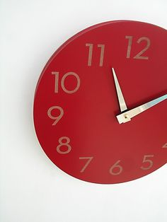 I love the clean look of this modern  clock ... especially because it's poppy red! By uncommon on Etsy, $59.00