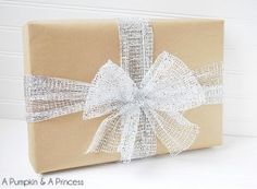 Love gift wrap that is rustic, but also styles that are metallic and sophisticated? Combine both of these wonderful materials with this Shabby Chic Gift Wrap. All you need is Kraft Paper and metallic ribbon.