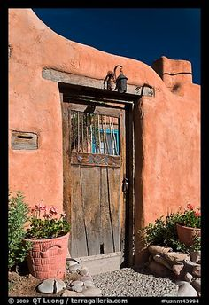 Picture/photo (Pueblo Architecture): Wooden door and adobe wall. Santa Fe, New Mexico, USA