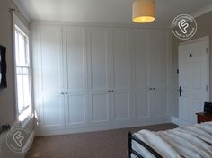 www.formcreations.co.uk. This is a full wall shaker style wardrobe giving a clean, unfussy appearance that sits well in period or modern style rooms. Measuring 3.5metres wide x 2.6metres tall with a internal depth of 600mm, the units were pre manufactured and painted, delivered and installed in less than 2 days. All units come with Blum soft close door hinges.
