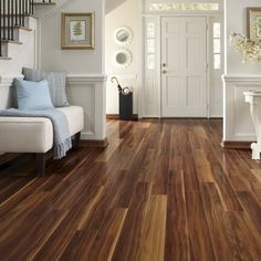 Pergo Visconti Walnut Laminate Flooring - in the kitchen, downstairs hall, and downstairs bathroom
