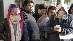 Immigrants brave the cold weather as they line up outside a California Department of Motor Vehicles office to register for drivers licenses in Stanton, Calif., Friday, Jan. 2, 2015. (AP)