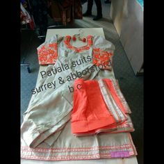 FRONT  Silk party wear Patiala suit.  Machine embordiery on neck and arms  With full Patiala Salwar with chinnon Dupatta.  $ 250 For more details  Call or WhatsApp +1-604-780-8190