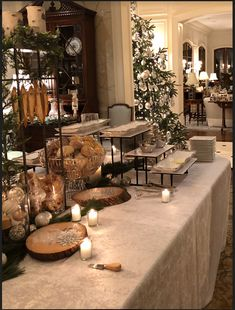 """- The Enchanted Home - This was taken just as the food table was getting set up….look how they """"hung"""" the crostinis, - Christmas Party Table, Christmas Cocktail Party, Christmas Open House, Christmas Party Decorations, Christmas Buffet Tablescapes, White Christmas, Food Table Decorations, Holiday Tables, Holiday Decor"""