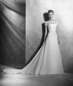 Virtud, schlichtes Brautkleid aus Spitze, doppellagiges Dekolleté, romantischer Stil