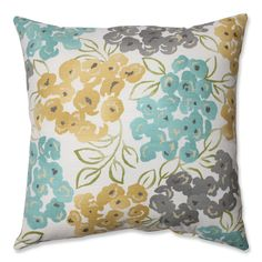 Add a bit of brightness to your living space with this floral throw pillow. It features multiple colors to help introduce a pop of vibrancy to the room. A knife edge gives the pillow a simple style. It's made of cotton over a polyester fill for comfort.