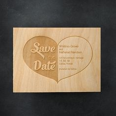 """""""Save the Date"""" fills the left side of the heart on this etched-wood save the date, the details of your upcoming wedding on the right."""