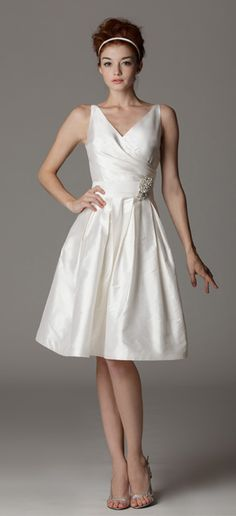 Style 141. Surplice wedding dress with built-in waistband. Available at Carrie Karibo Boutique Cincinnati, Ohio www.carriekaribo.com