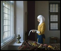 """© JAN BANNING 20070402 From the series """"National Identities"""".  Maroccan girl (Nissrine) reading an application form for an """"inburgeringscursus"""" (citizenship course) at a closed window"""