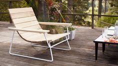 A low-profile, outdoor lounge chair with clean lines and a modern profile that removes extraneous details leaving a minimal chair with a simple curve.