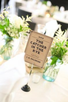 Tables named after the bride & groom's favorite books. Cate Jackson Photography www.catejacksonphoto.com