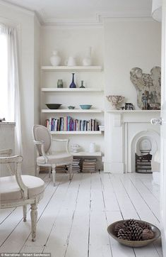 Contemporary shelving in room with bare painted floorboards London townhouse England UK. Painted Wooden Floors, White Painted Floors, White Wooden Floor, White Flooring, White Washed Floors, Wooden Flooring, Vinyl Flooring, Living Room White, White Rooms