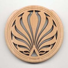 The shape of this laser cut coaster creates a sense of direction towards the centre. This, along with the lines, give a sense of movement and makes this coaster feel balanced.