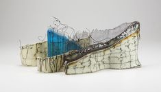 Carol Carson, Bound, 2010, kilnformed glass, steel wire, 6.75 x 14.5 x 6.25 inches (installed). Photography: M. Endo.