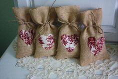 Burlap gift bags with red toile hearts.