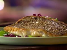 Seared Black Bass with Bitter Greens, Grapefruit and Feta Salad Recipe : Food Network - FoodNetwork.com