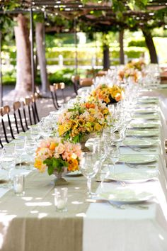 Family style reception table in bright yellow flowers. Romantic Wedding Centerpieces, Wedding Reception Tables, Wedding Decorations, Table Decorations, Wedding Ideas, Wedding Flowers, Centerpiece Ideas, Flower Centrepieces, Wedding Planning