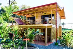 Decorating Your American Bungalow Style House Thai House, Bamboo House Design, Small House Design, Rest House, House In The Woods, Style At Home, Bungalow Style House, Bali, House On Stilts