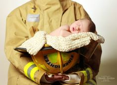 Amanda Abraham Photography specializing in newborn and child family photography. Newborn neutral color scheme with using colors close to the skin tone to make the newborn stand out. Photographer in the Metro Detroit, Michigan area with a home studio, using props and textured blankets with posing to add to a whimsical newborn portrait photo experience! Posing with a parent in firefighter uniform gear.