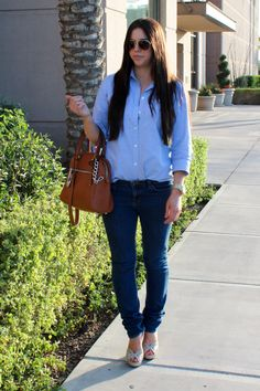 Courtney Fox from Courioefox Personal Style blog wearing a Michael Kors tote bag. March 2012