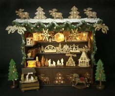 Charming German Miniature Christmas Market Stall displaying wooden ornaments - by DinkyWorld