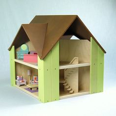 Custom Cottage with brown roof & light green sides $325.00