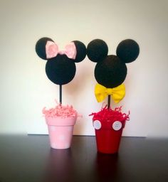 This listing is for one pair of Minnie & Mickey Centerpieces (2 pieces). They both stand 14 tall and 4.5 wide. The Minnie and Mickey heads are painted