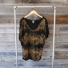 'Seventy Two Changes' loose animal print tunic | Studded details | Size: Large | Like new | $12 | See Instagram @Robert NOIR to purchase.