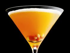 Candy Corn Martini  1/2 oz - Vanilla Vodka  1/2 oz - Orange Vodka  1/2 oz - Creme de Cocoa  1/2 oz - Butterscotch Schnapps  1 oz - Orange juice  Rim the martini glass w/ OJ & cocoa powder Shake all inexpedience & strain   Garnish with a piece of candy corn at the bottom of glass
