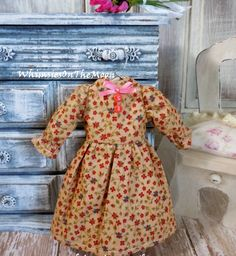 This listing is for one 3/4 puffed sleeves floral dress.  This dress is both hand and machine sewn by me with pretty ribbon and buttons details. **It has lined bodice and fully finished back seams with snap closures**   This dress is made to fit Kenner/Takara Blythe dolls and similar size dolls.  All fabrics are pre-shrunk and I recommend hand washing using mild detergent if needed.  Listing is for the dress only.   Thank you for visiting Whimsies On The Moon