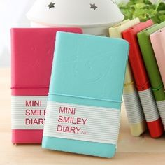 "*Blind+bag+item:+Color+received+is+RANDOM!*    The+very+cute-styled+pages+in+this+smiling+notebook+will+record+all+of+your+happy+thoughts!    Cover+Material:Imitation+Leather  Color:Random+Color  Size(LXWXH):13cmX8.3cmX1.2cm  +++++++++++++++++++++++++5.1""X3.3""X0.5""  Amount+Of+Paper:192    Package..."