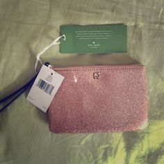 NWT. FINAL REDUCTION Kate Spade Wristlet PRICE IS FIRM.....NWT. Beautiful shimmery rose gold color. Fits iPhone 6plus!  almost 7inches in length and 4.5in in height kate spade Bags Clutches & Wristlets