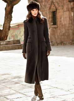 Transcending time and trend, our classic coat is tailored to perfection in a lush blend of caramel baby alpaca (67%) and wool (33%). Accented with espresso suede at the collar and pockets, the fit-and-flare shape makes an elegant day or night statement; fully lined.