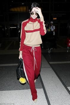 Comfort over style: She matched her shoes to her tracksuit as she paraded through departures