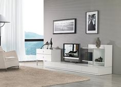 """The Maryland 3 piece entertainment center features the latest trends in TV stands including a window pane on the right, storage unit for media discs and computers hooked up to the TV on the left, and can fit a TV as big as 52"""" in the low profile bottom piece, and a large amount of additional storage under the TV."""