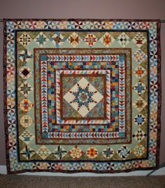 Covington Medallion Quilt by Lesliequilter on Etsy, Love the different on-point blocks in the secondmost outer border!