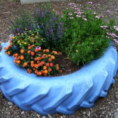 I have always loved old tractor tires as sand boxes, this one painted & converted to a planter takes it to the next step in it's repurposed life.