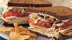 No cooking required! Enjoy these cheesy chicken and vegetable sandwiches made with pumpernickel rye bread -  in just 10 minutes.