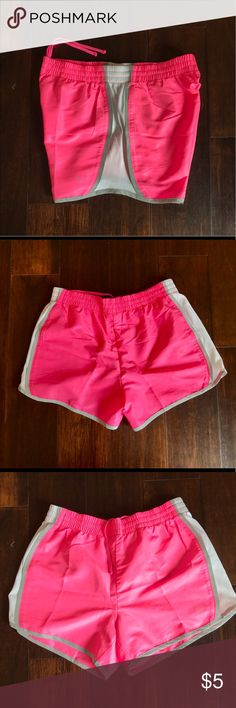 """Neon pink gym shorts in size S The shorts have no inner lining, and is made out of a thin and light weight material. It's from the brand """"danskin"""" Shorts"""