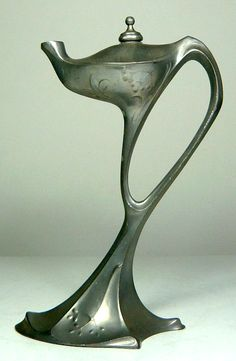 KAYSERZINN Art Nouveau pewter oil lamp for lighting cigars, German, attributed to Albin Müller. (Has also been attributed to Hugo Leven.)